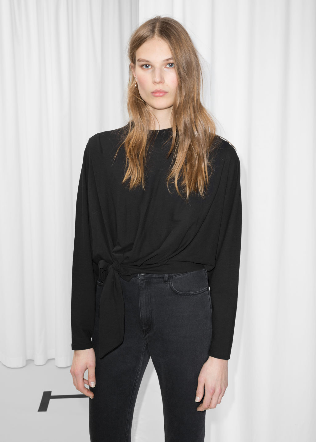 Model front image of Stories side tie top  in black