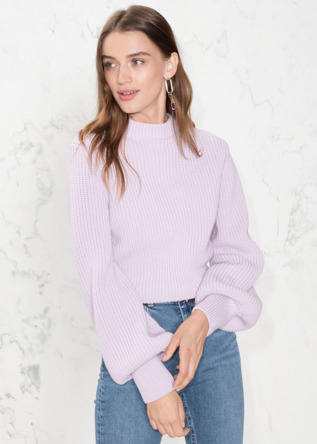 Model front image of Stories cropped mock neck sweater in purple