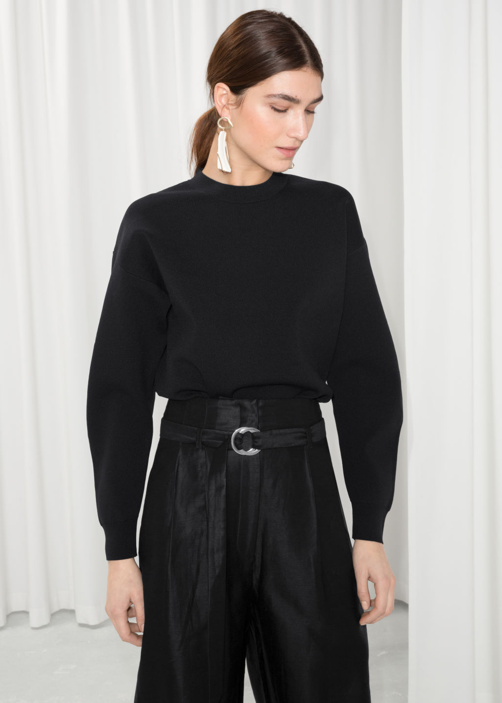 Model front image of Stories structured sweater in black