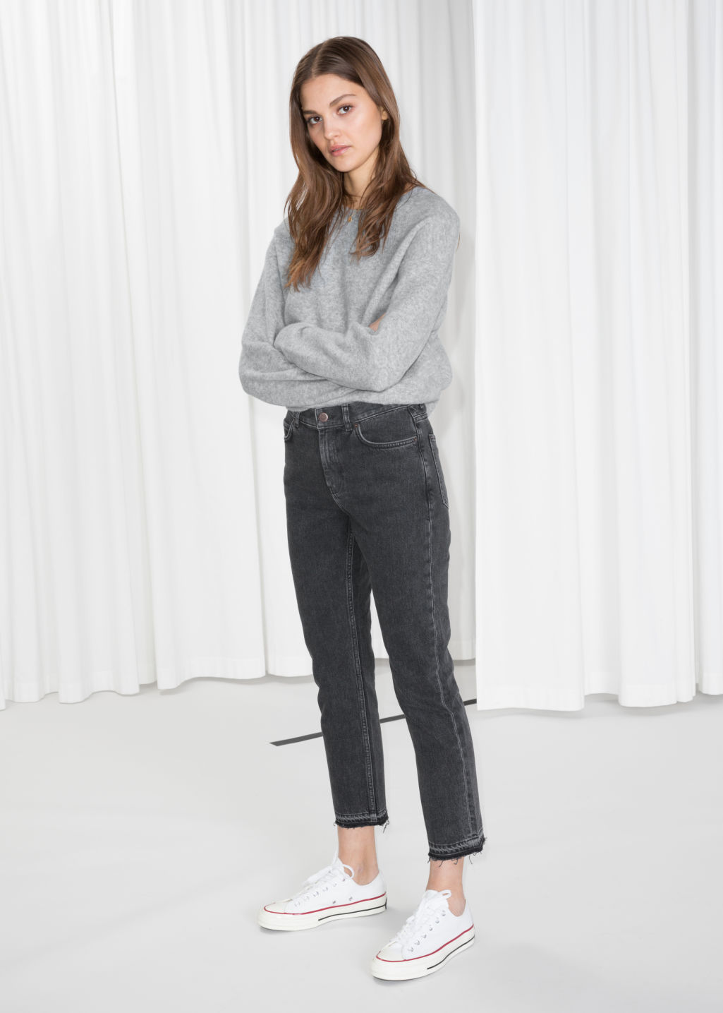 Model front image of Stories raw edge slim jeans in black