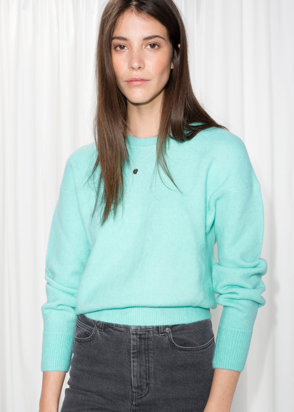 Model front image of Stories crewneck sweater in turquoise