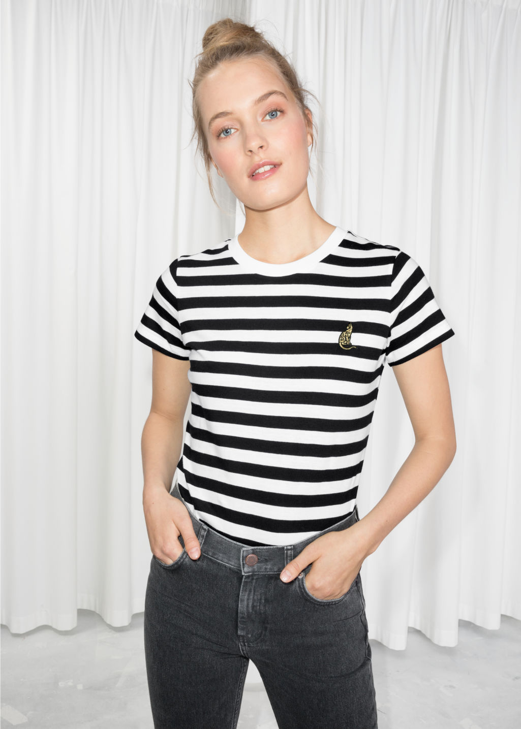 Model front image of Stories micro patch t-shirt in black