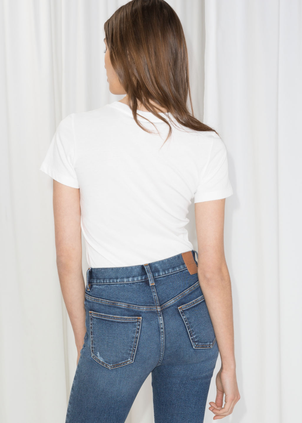 Model back image of Stories micro patch t-shirt in white