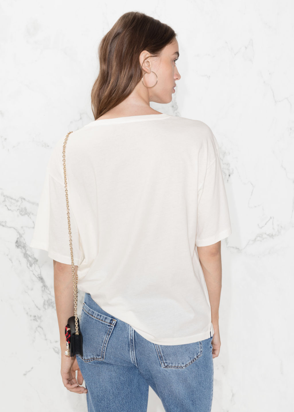 Model back image of Stories slogan tee in white