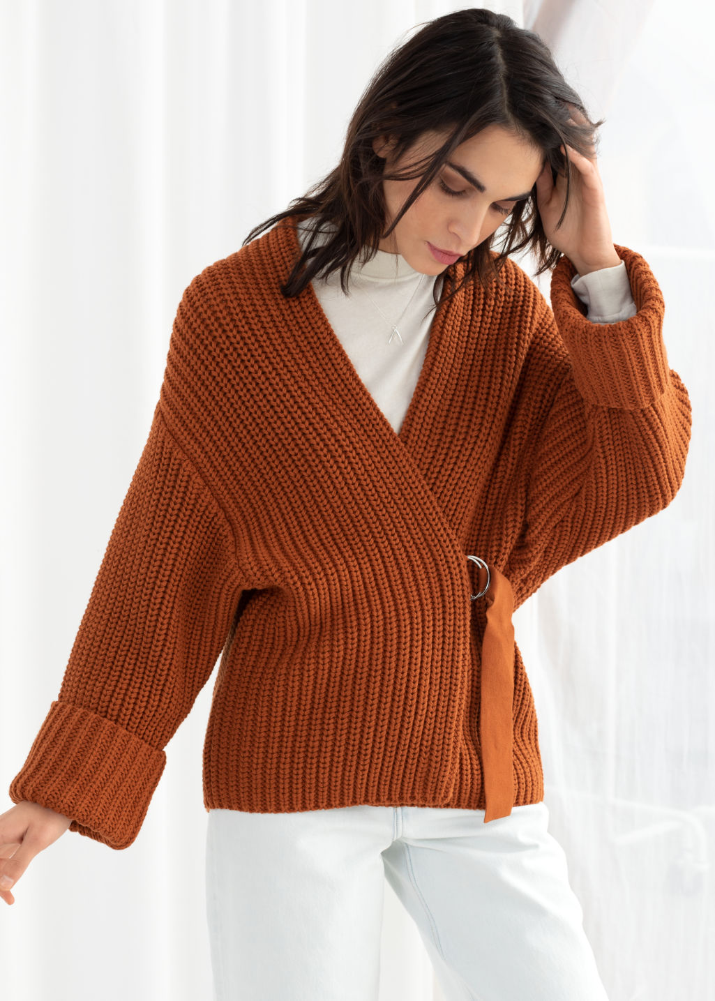 Model front image of Stories belted cardigan in orange