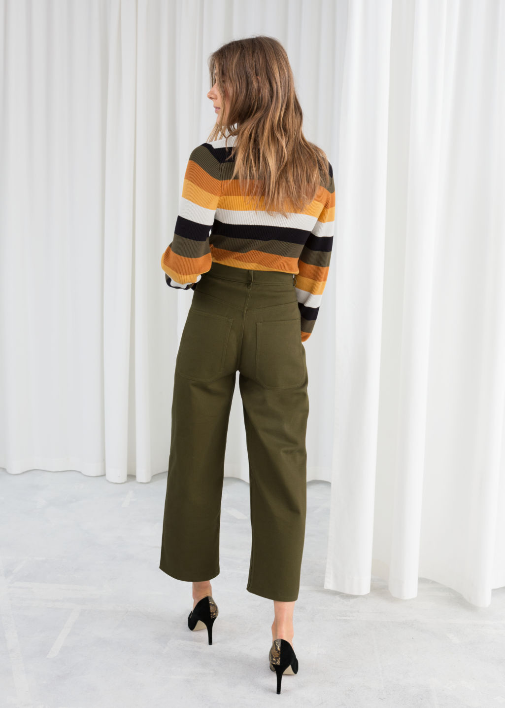 Model back image of Stories workwear culottes in green