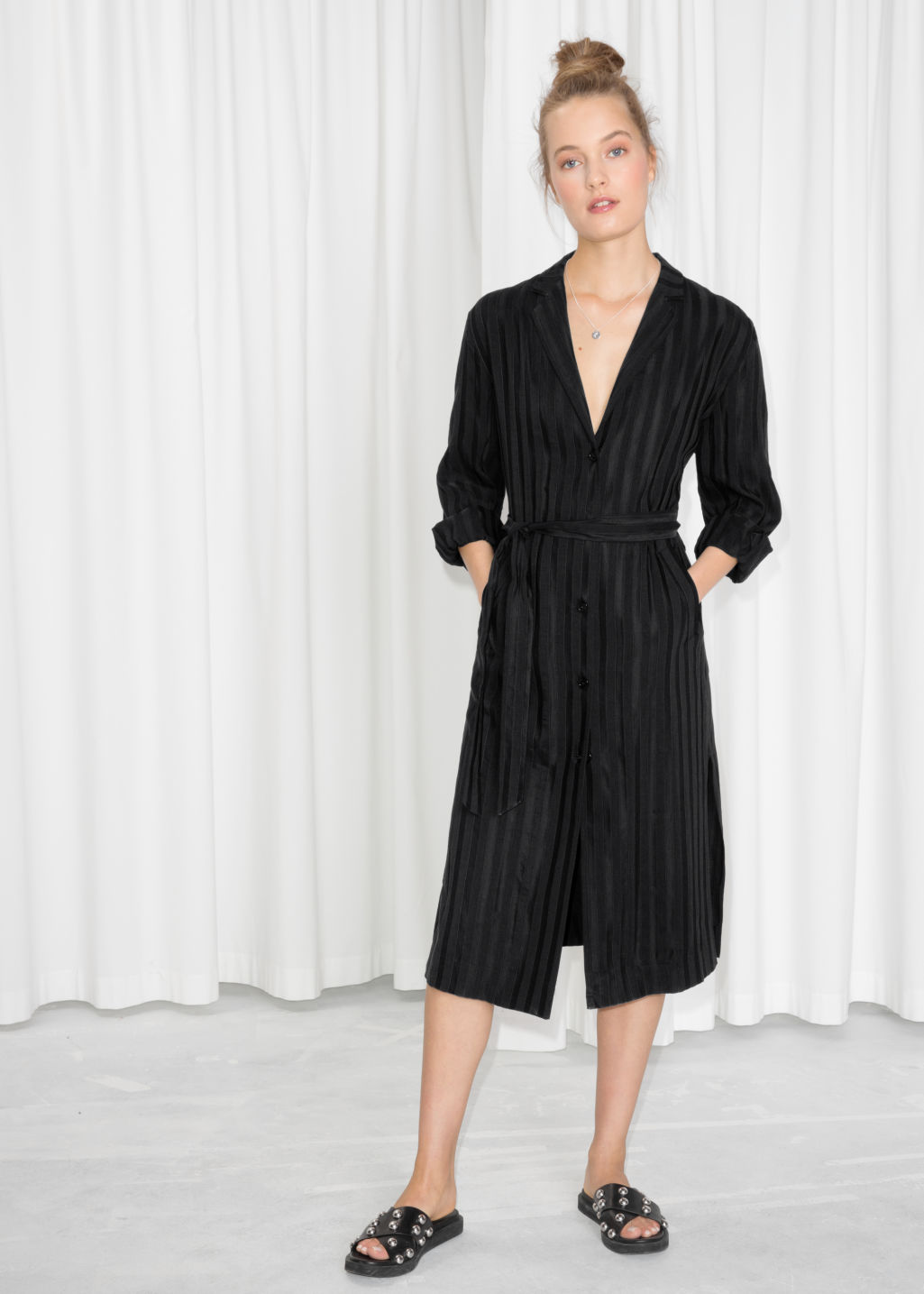 Model front image of Stories belted blazer dress in black