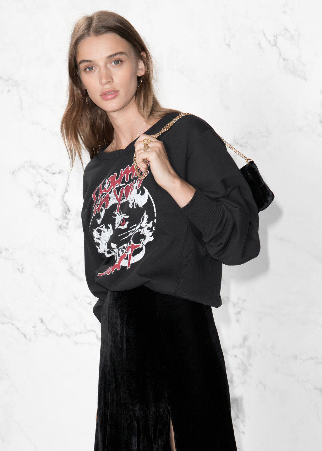 Model front image of Stories oversized crop sweater in black