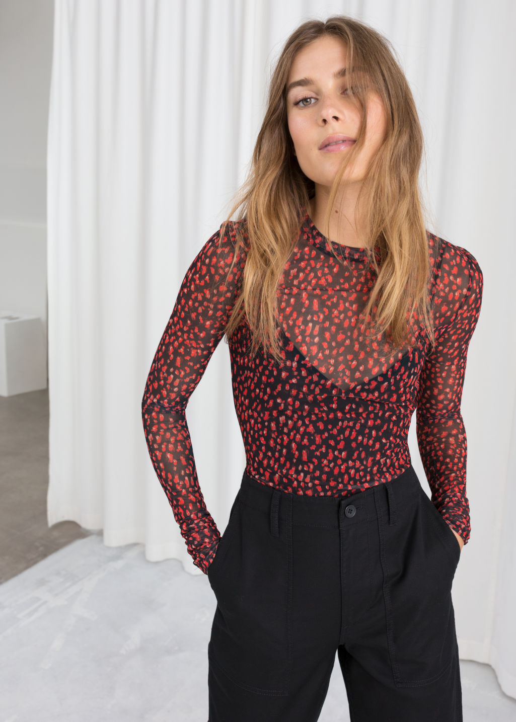 Model front image of Stories printed sheer top in red