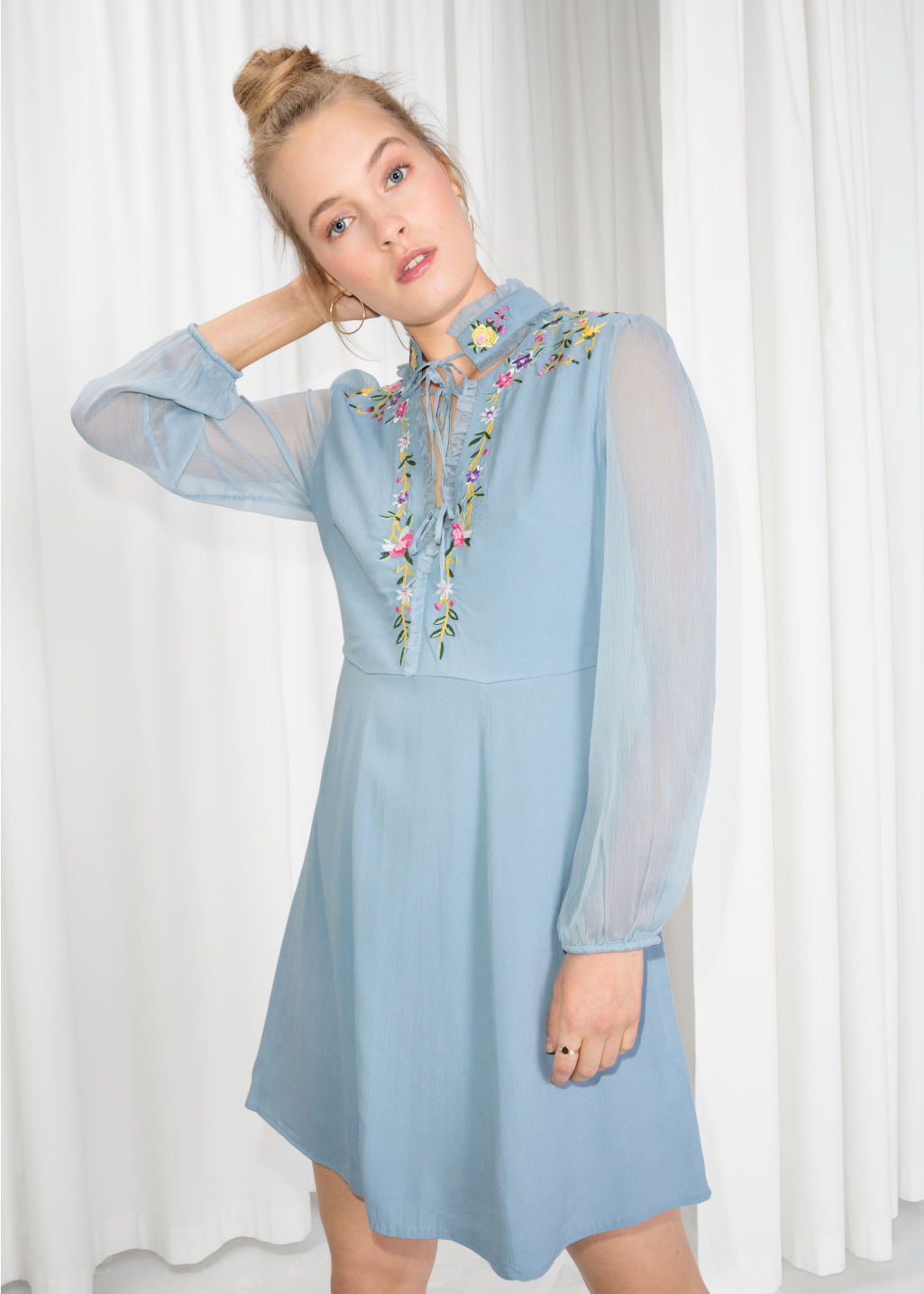 Model front image of Stories floral embroidered dress in blue