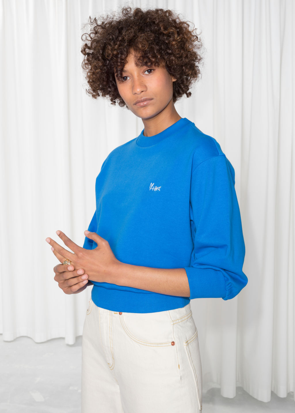 Model front image of Stories embroidered cropped pullover in blue