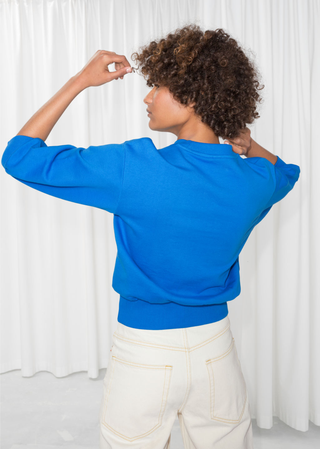 Model back image of Stories embroidered cropped pullover in blue
