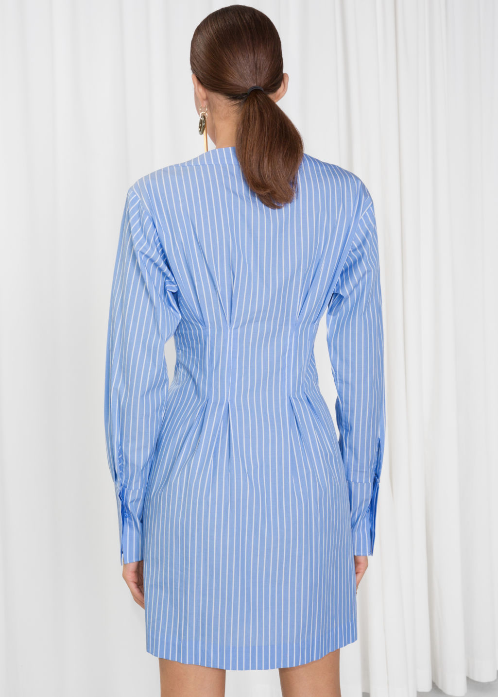 Model back image of Stories pin stripe fit and flare dress in blue