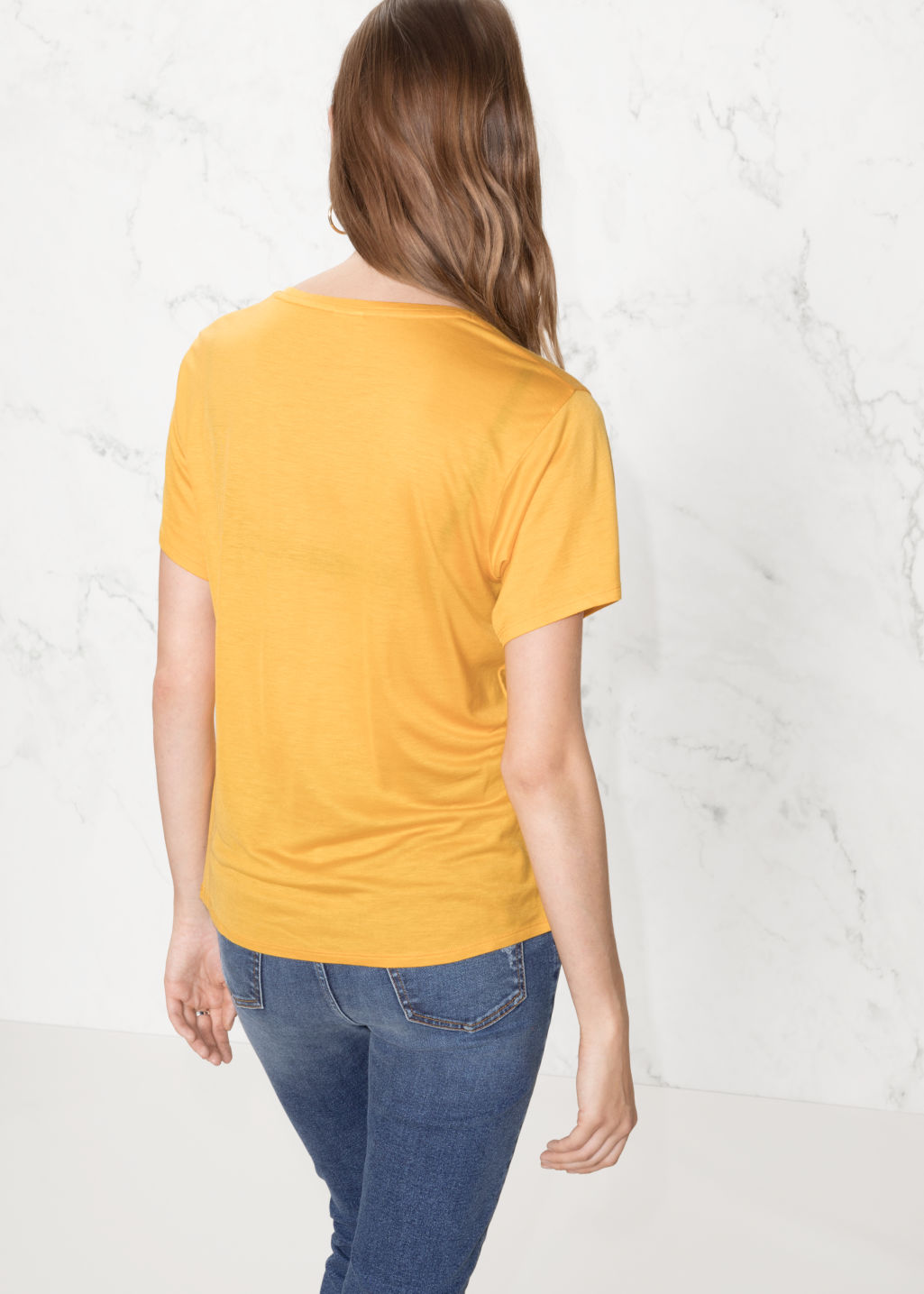 Model back image of Stories relaxed fit jersey tee in yellow