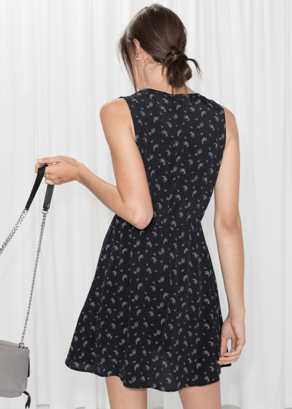 Model back image of Stories sleeveless print skater dress in black