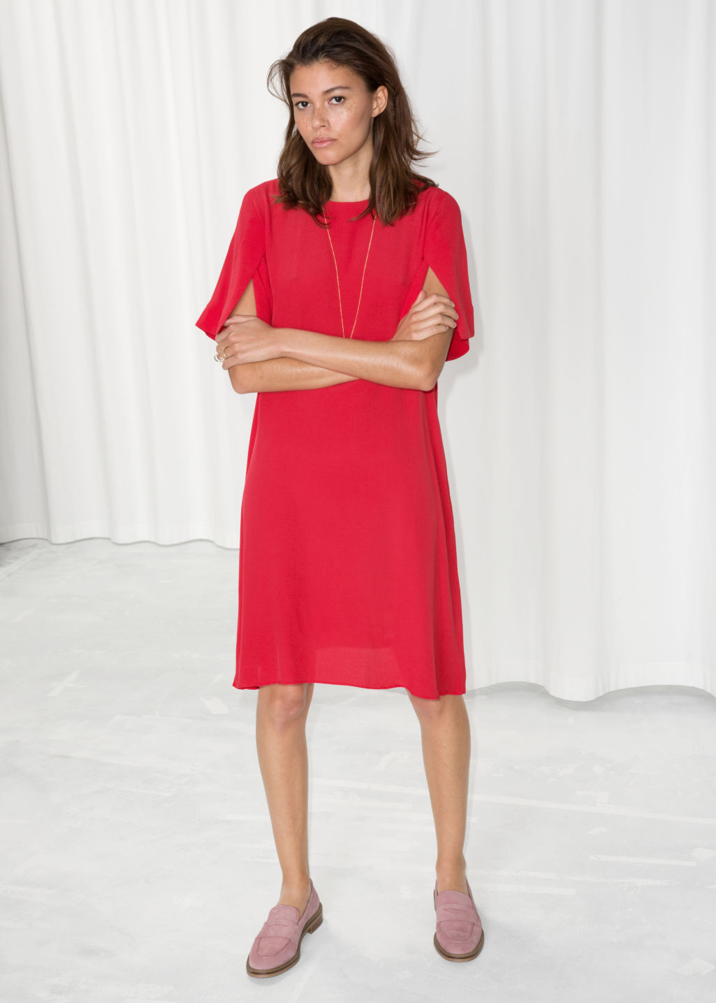 Model front image of Stories flared sleeve slit dress in red