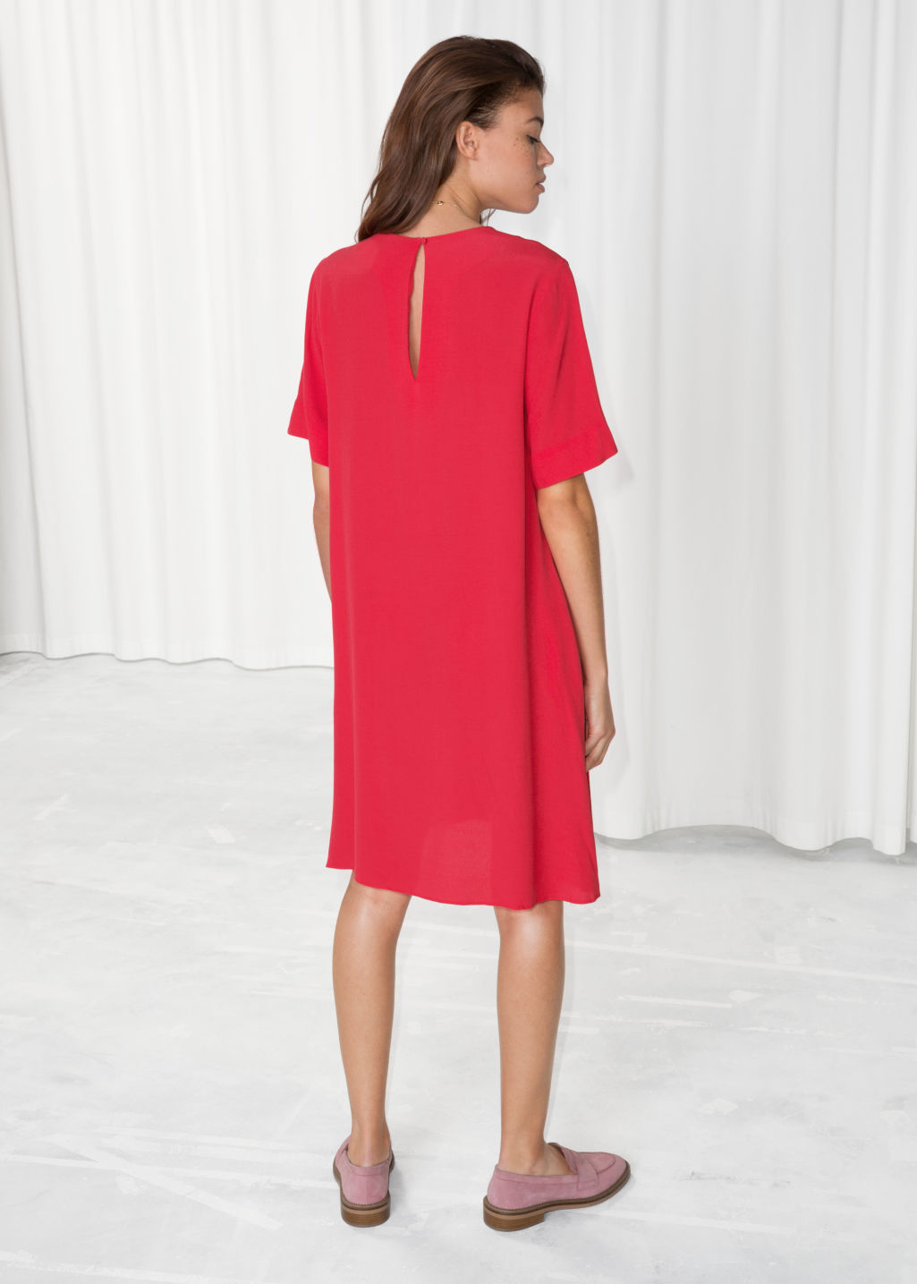 Model back image of Stories flared sleeve slit dress in red