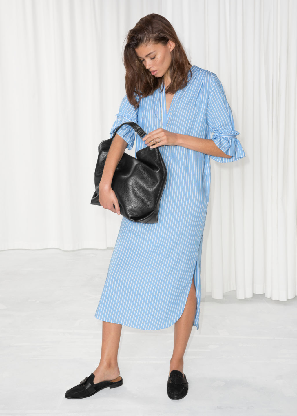 Model front image of Stories frill sleeve shirt dress in blue