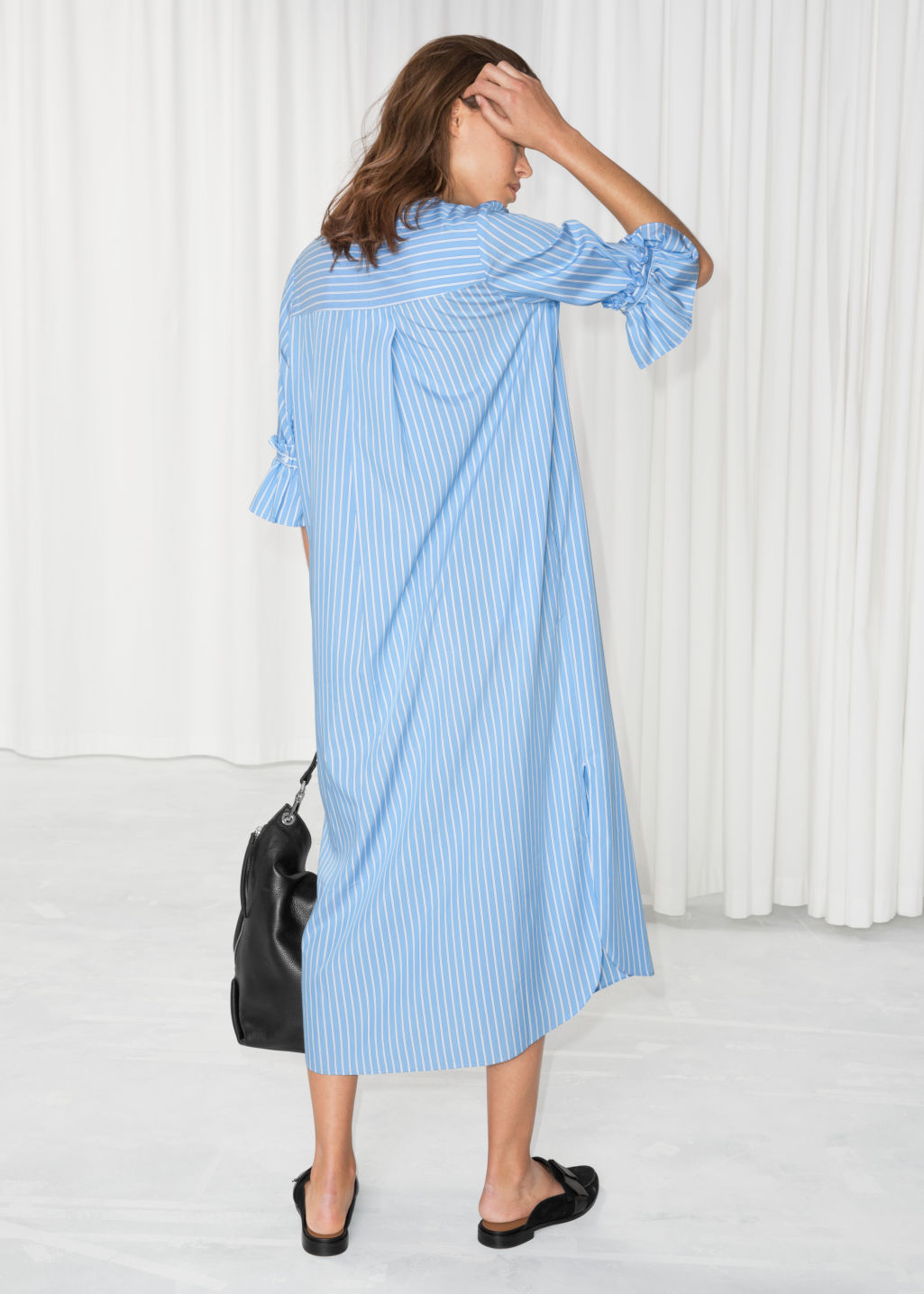 Model back image of Stories frill sleeve shirt dress in blue