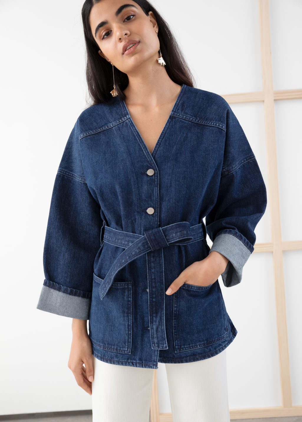 Model front image of Stories belted denim jacket in blue