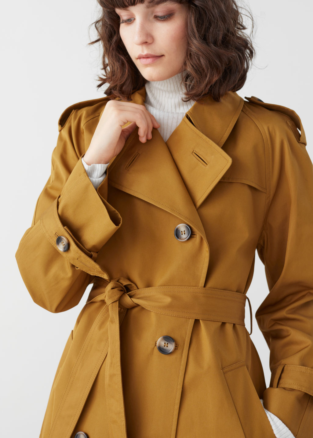 Model front image of Stories belted trench coat  in yellow