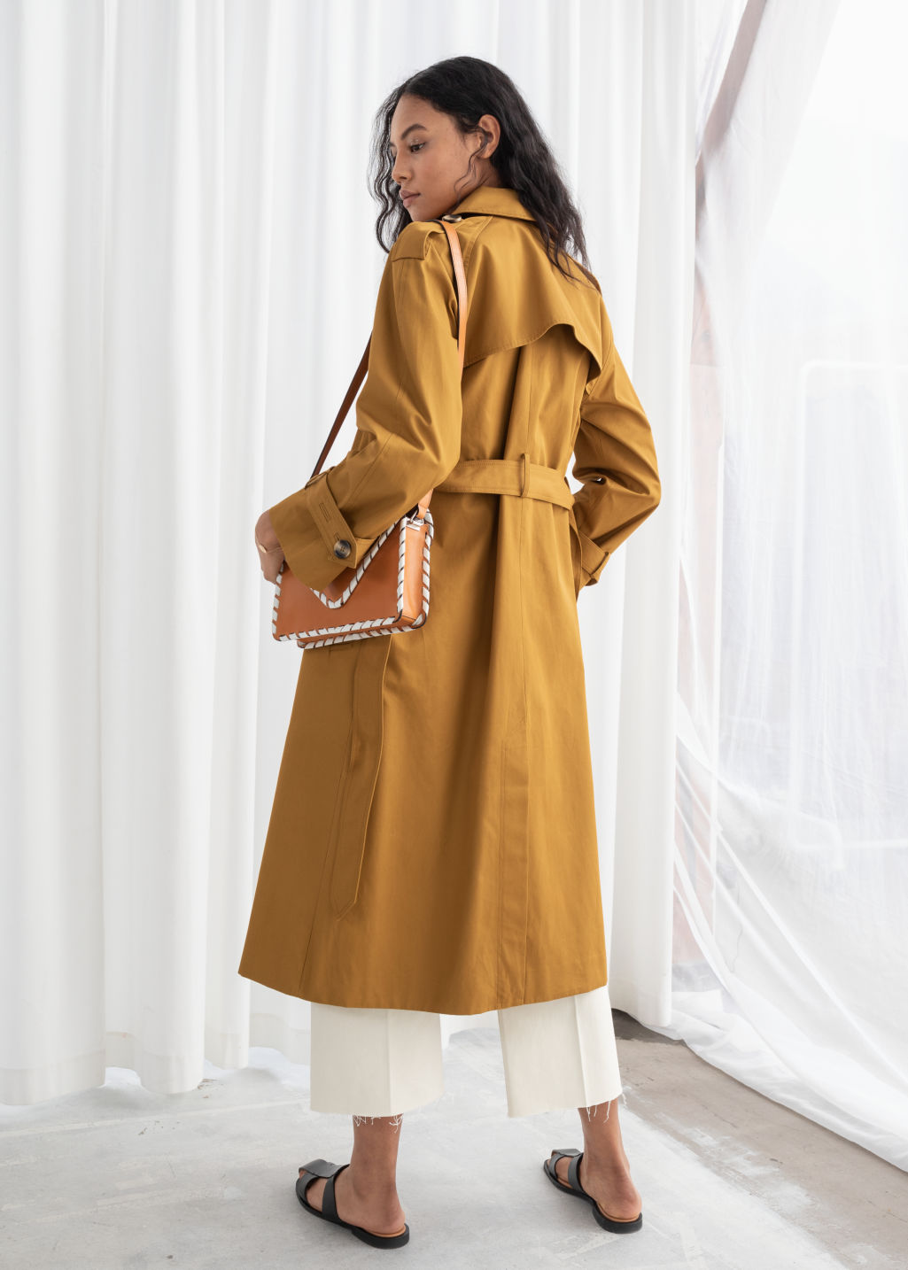 Model back image of Stories belted trench coat  in yellow