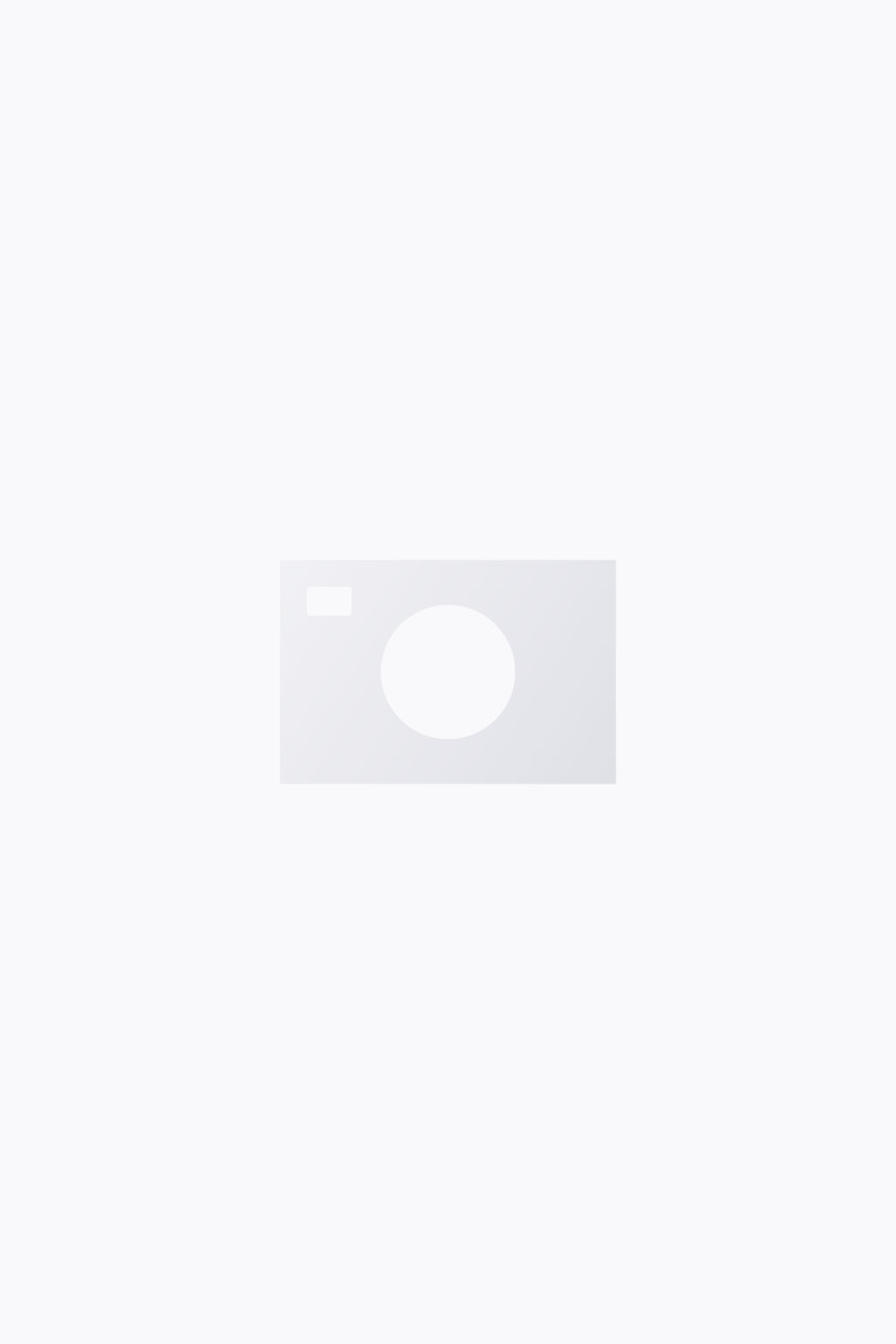 Model front image of Stories floral print quilted jacket in blue