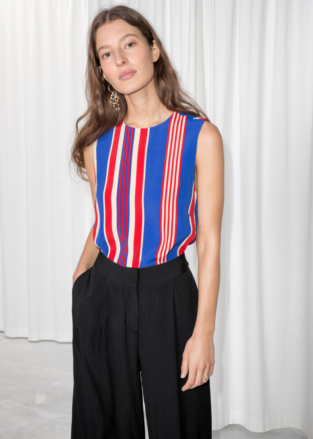 Model front image of Stories sleeveless crepe top in red