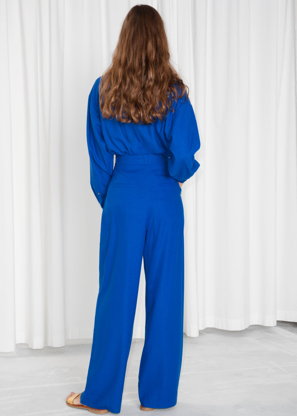 Model back image of Stories high waisted wide trousers in blue