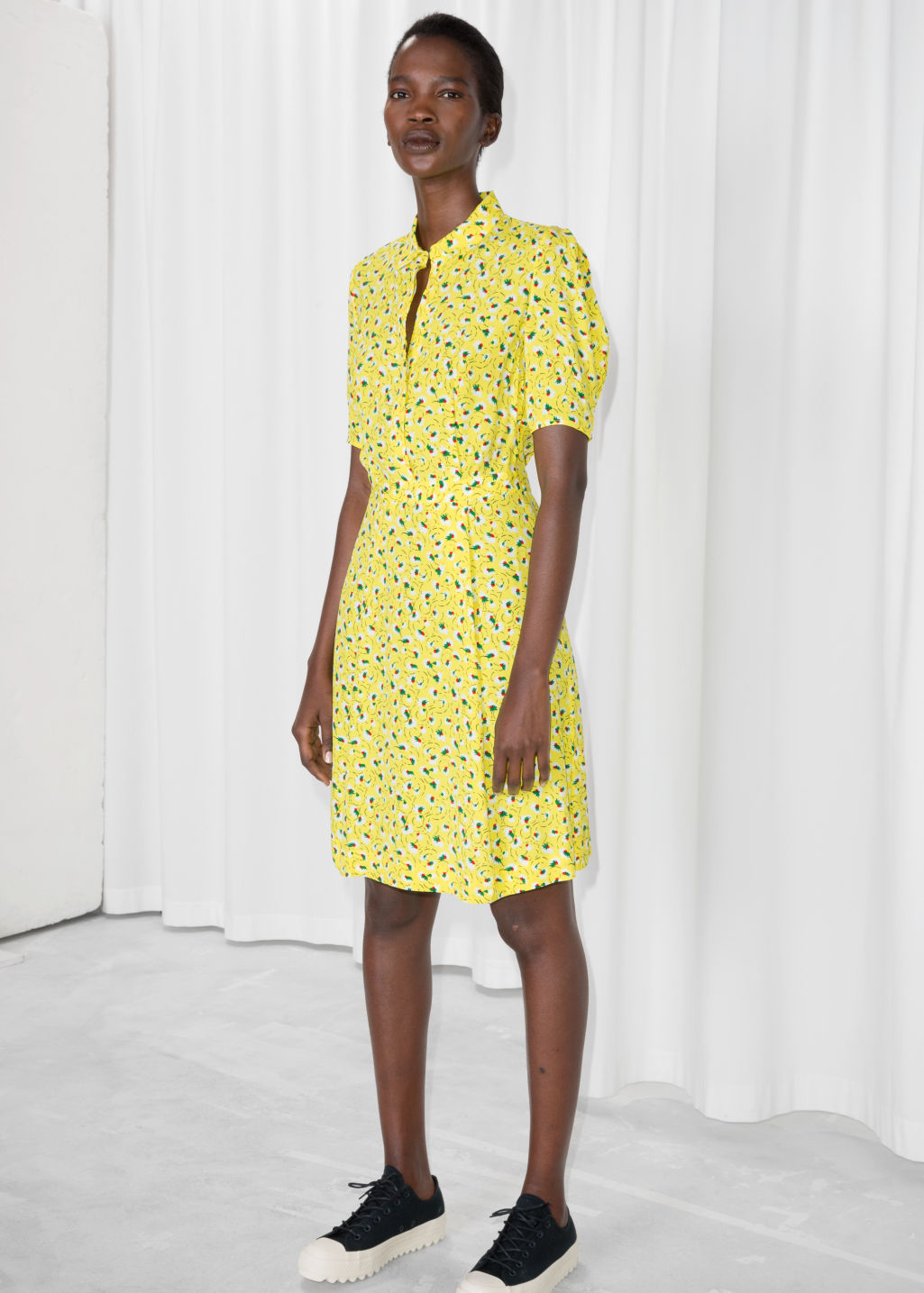 Model front image of Stories fit and flare dress in yellow