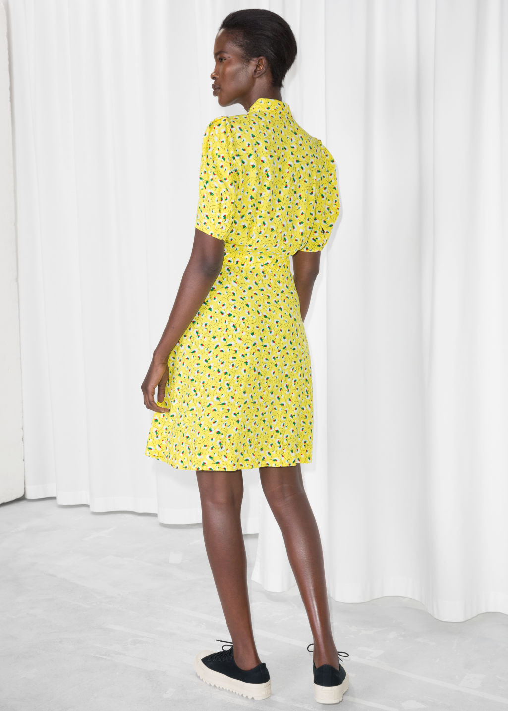 Model back image of Stories fit and flare dress in yellow
