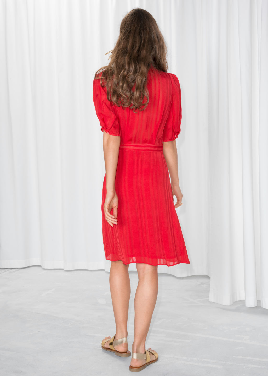 Model back image of Stories fit and flare dress in red