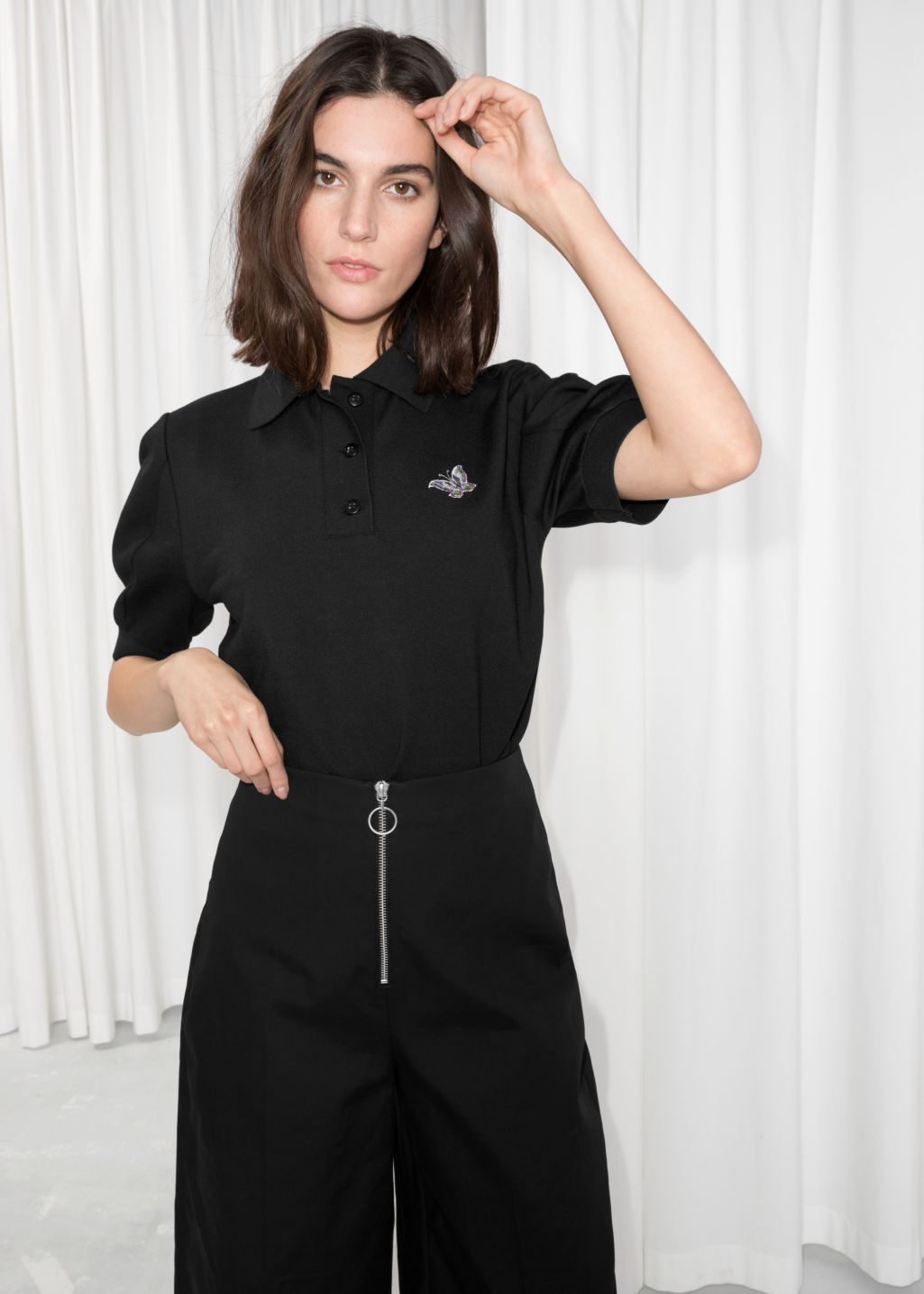 Model front image of Stories patch polo shirt in black