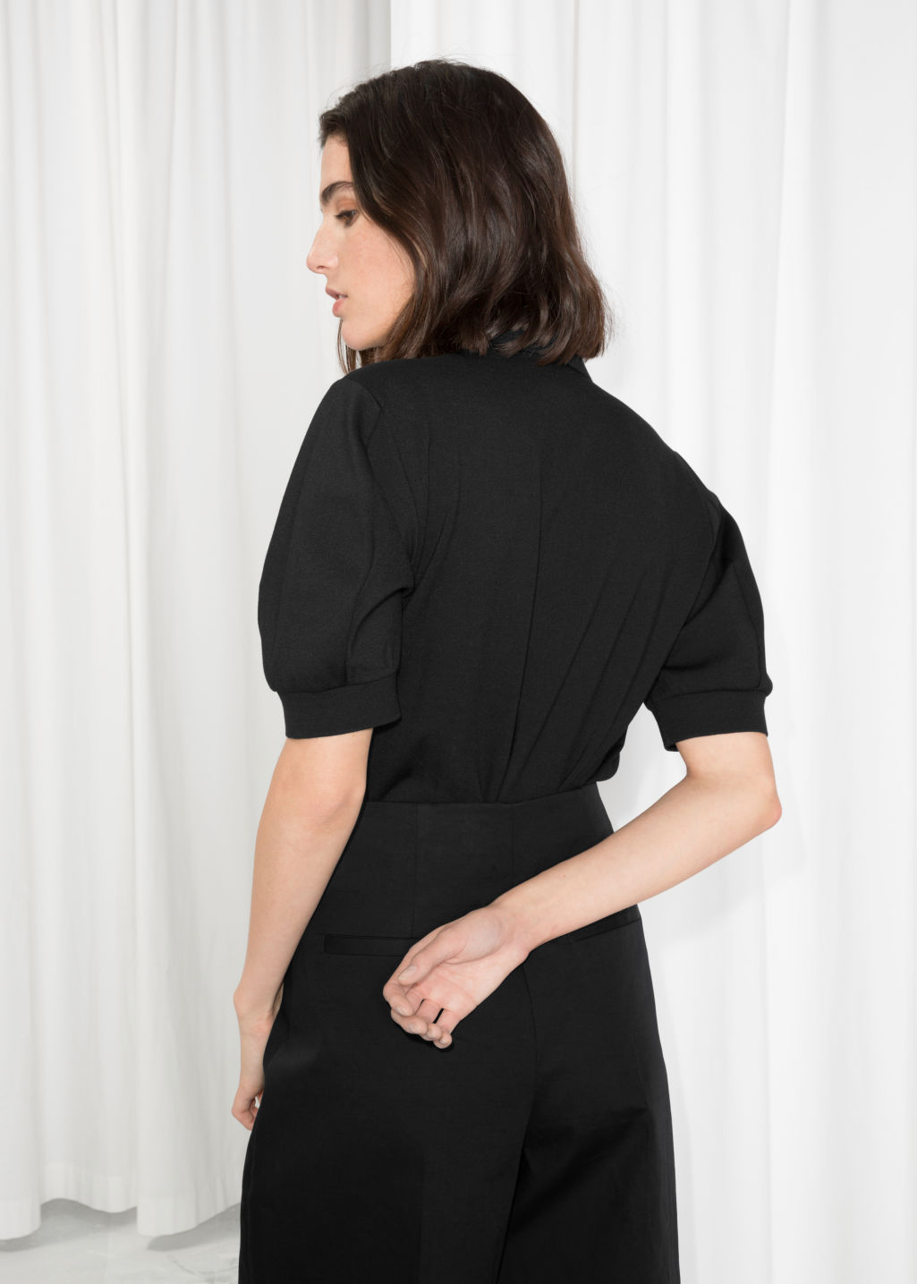 Model back image of Stories patch polo shirt in black