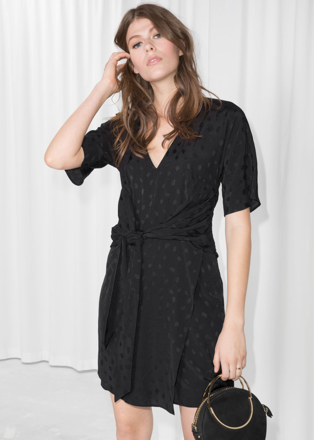 Model front image of Stories jacquard twist tie dress in black