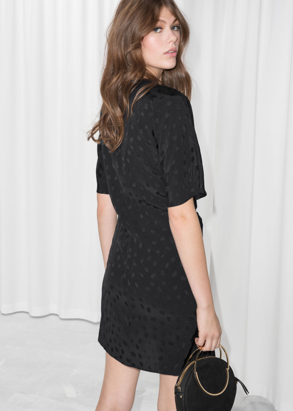 Model back image of Stories jacquard twist tie dress in black
