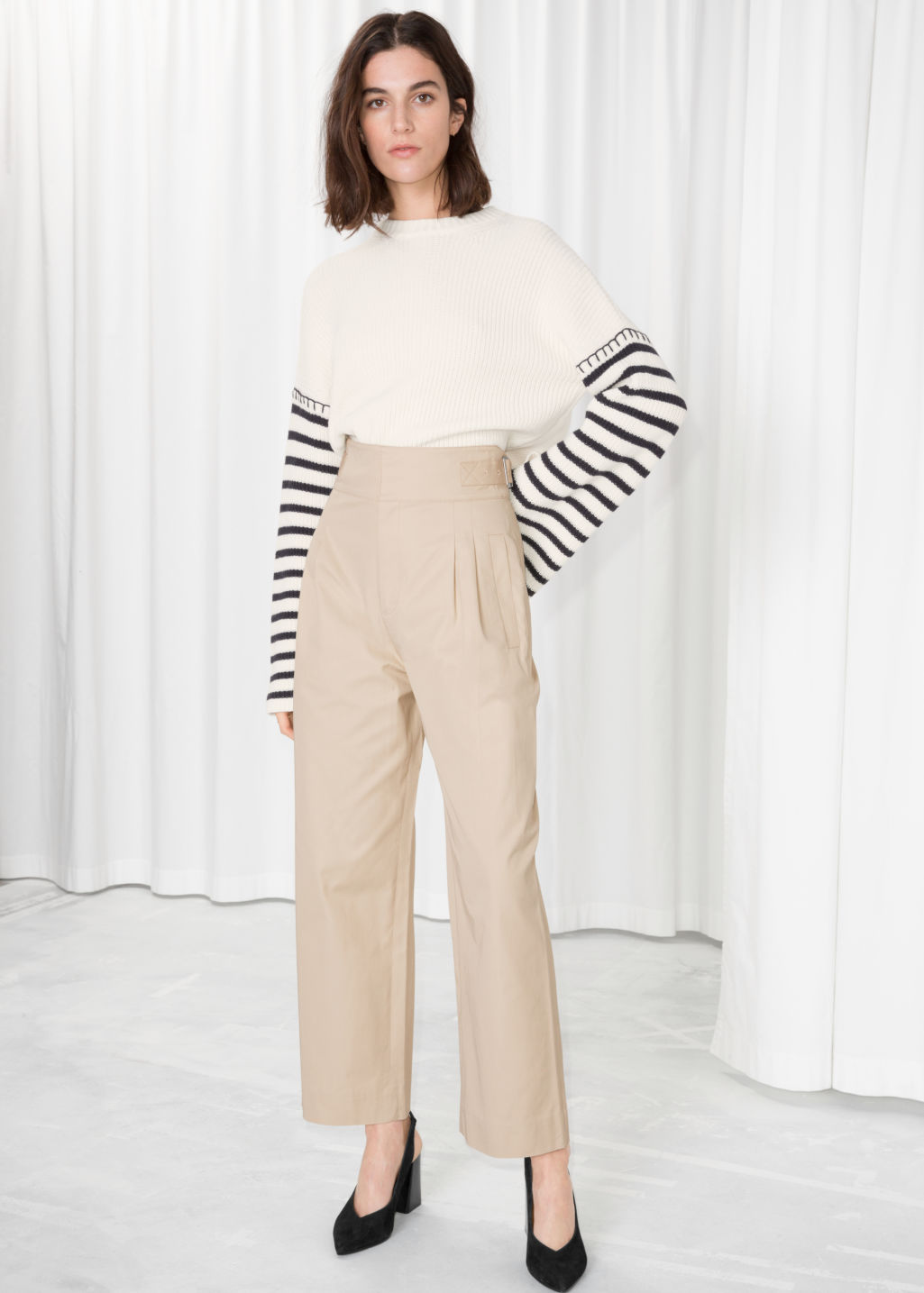 Model front image of Stories safari trousers in beige
