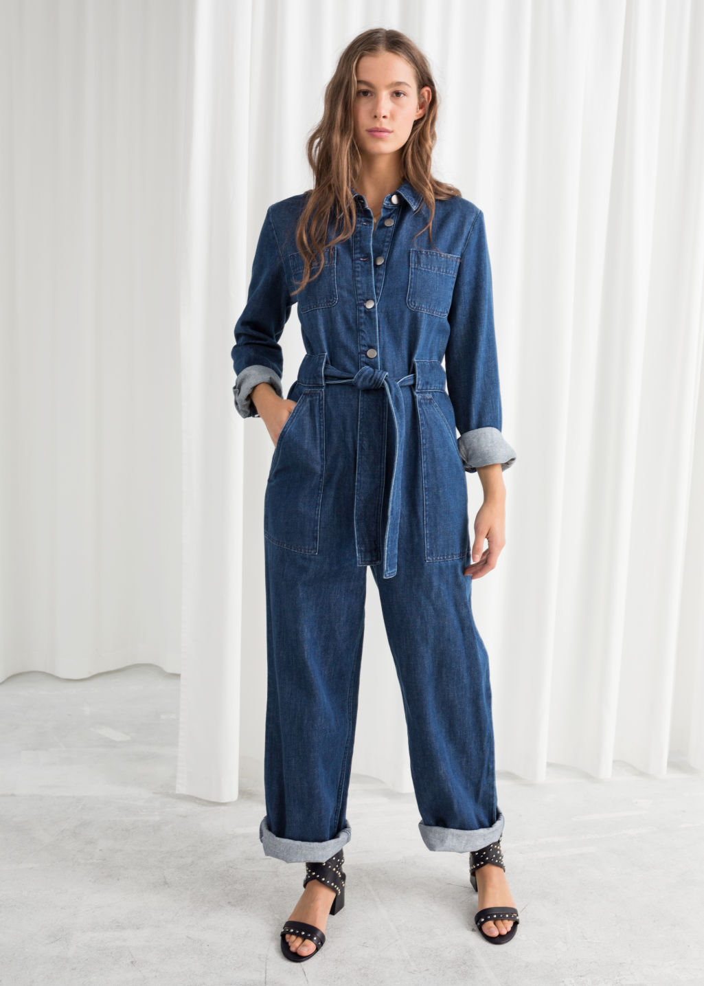 Model front image of Stories denim overall jumpsuit  in blue