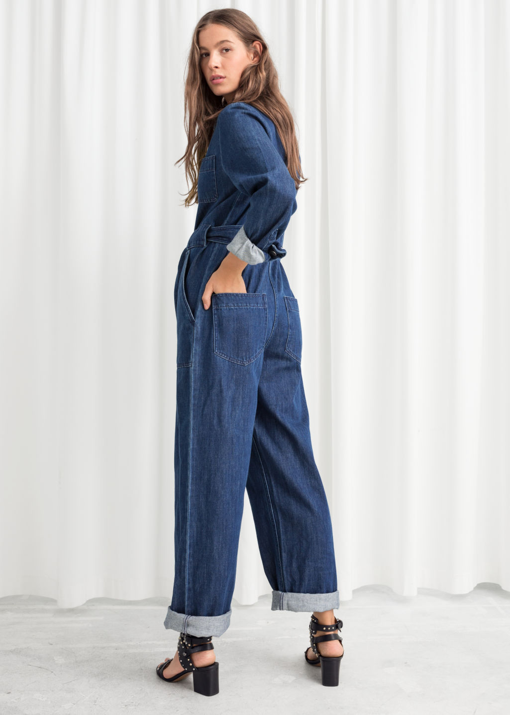 Model back image of Stories denim overall jumpsuit  in blue