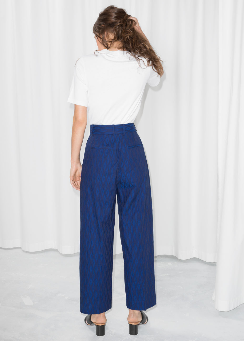 Model back image of Stories high rise patterned trousers in blue