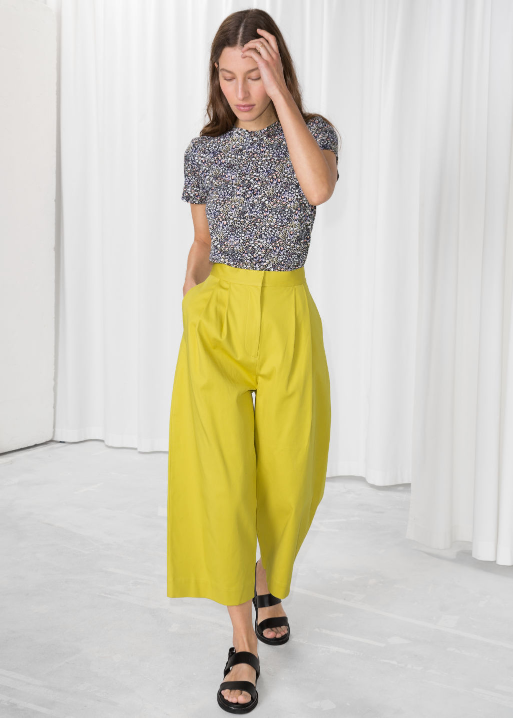 Model front image of Stories loose fit trousers in yellow