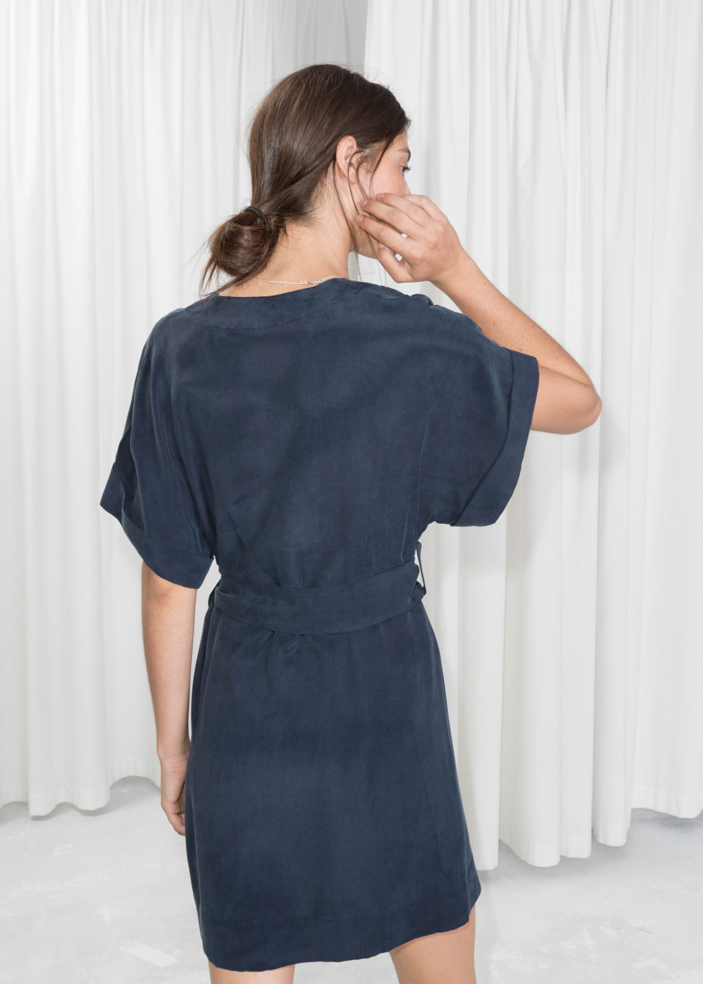 Model back image of Stories belted wrap mini dress in blue
