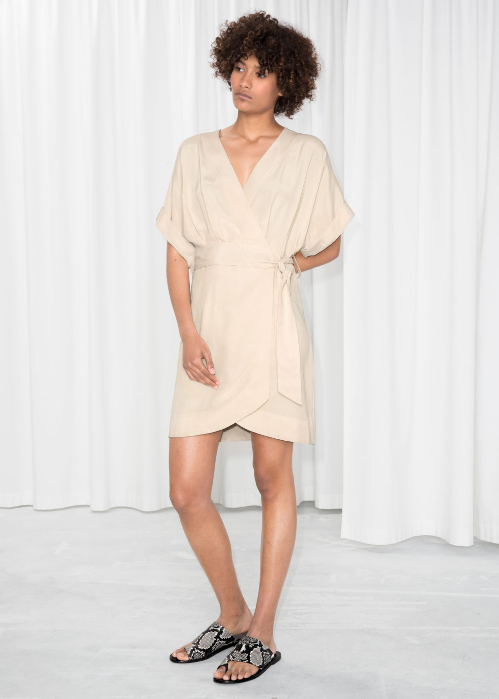 Model front image of Stories belted wrap mini dress in beige