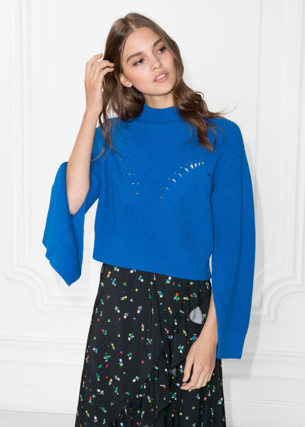 Model front image of Stories slit sleeve sweater in blue