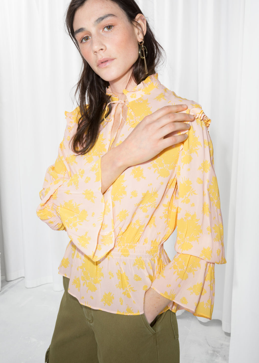 Model front image of Stories bell sleeve blouse in yellow