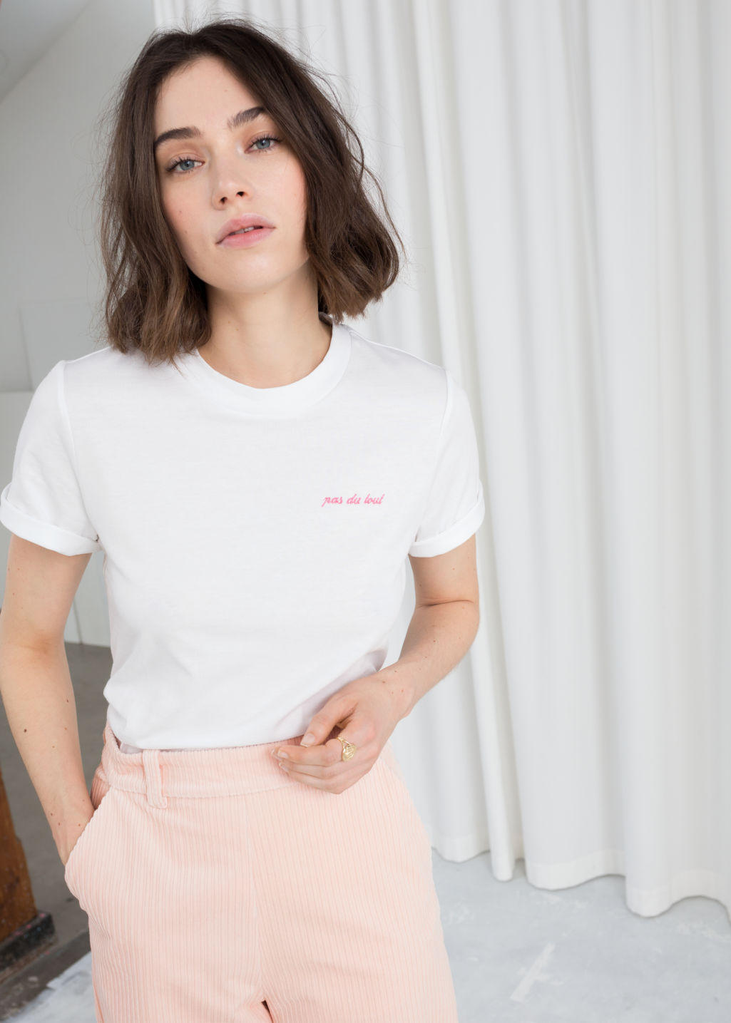 Model front image of Stories embroidered pas du tout tee in white