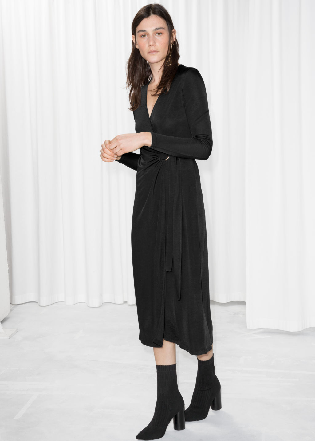 Model front image of Stories o-ring belted midi dress in black