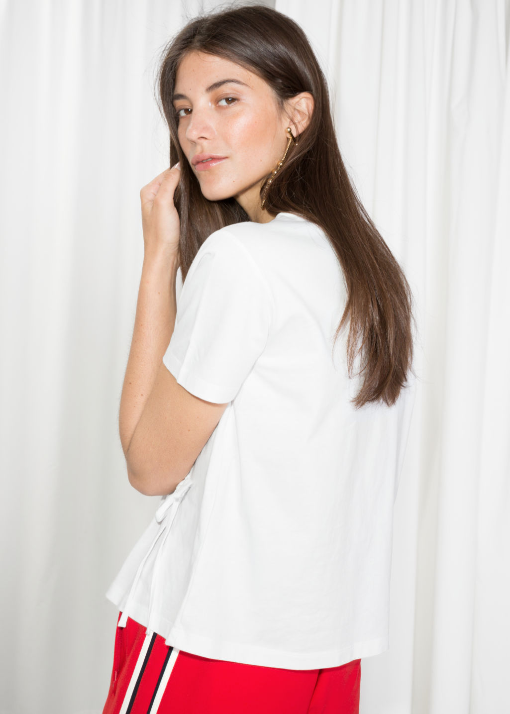 Model back image of Stories drawstring waist tee in white