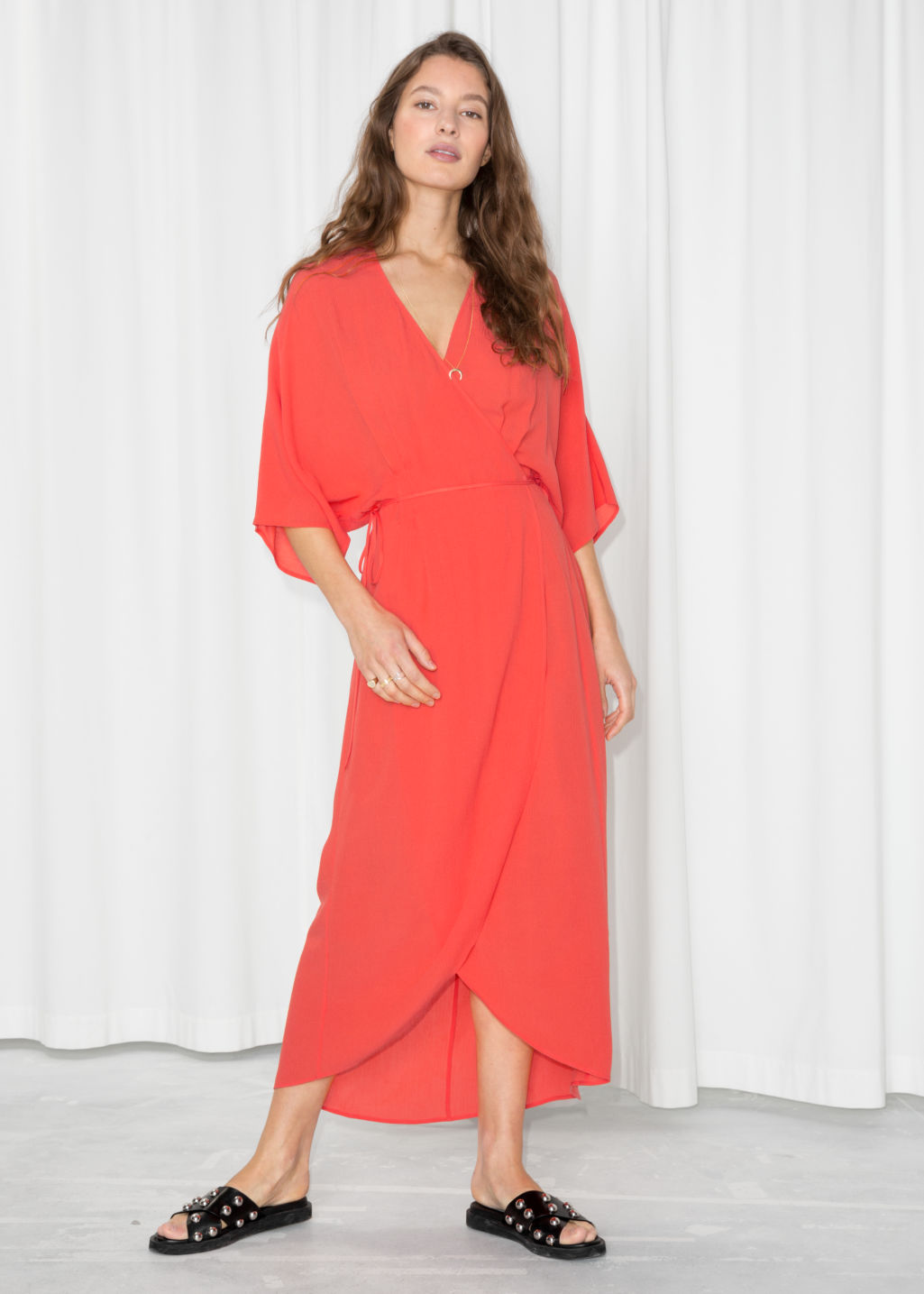 Model front image of Stories maxi kaftan wrap dress in orange