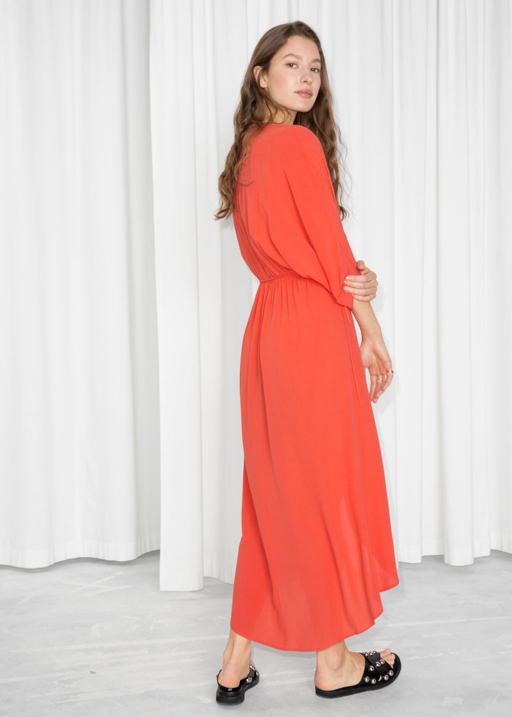 Model back image of Stories maxi kaftan wrap dress in orange
